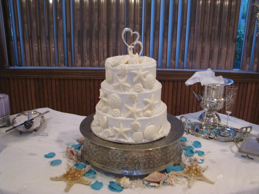 white wedding cake with beach theme