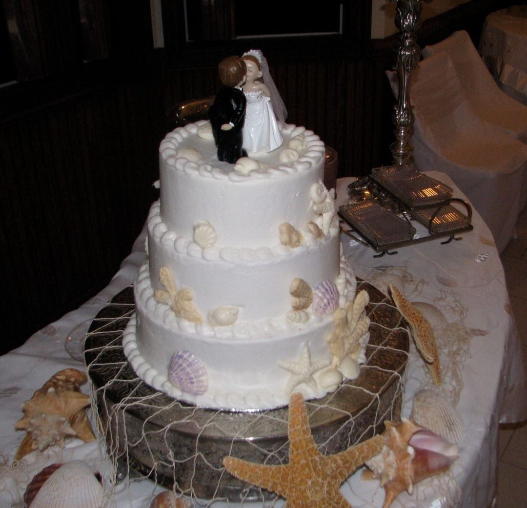 white wedding cake with seaside theme