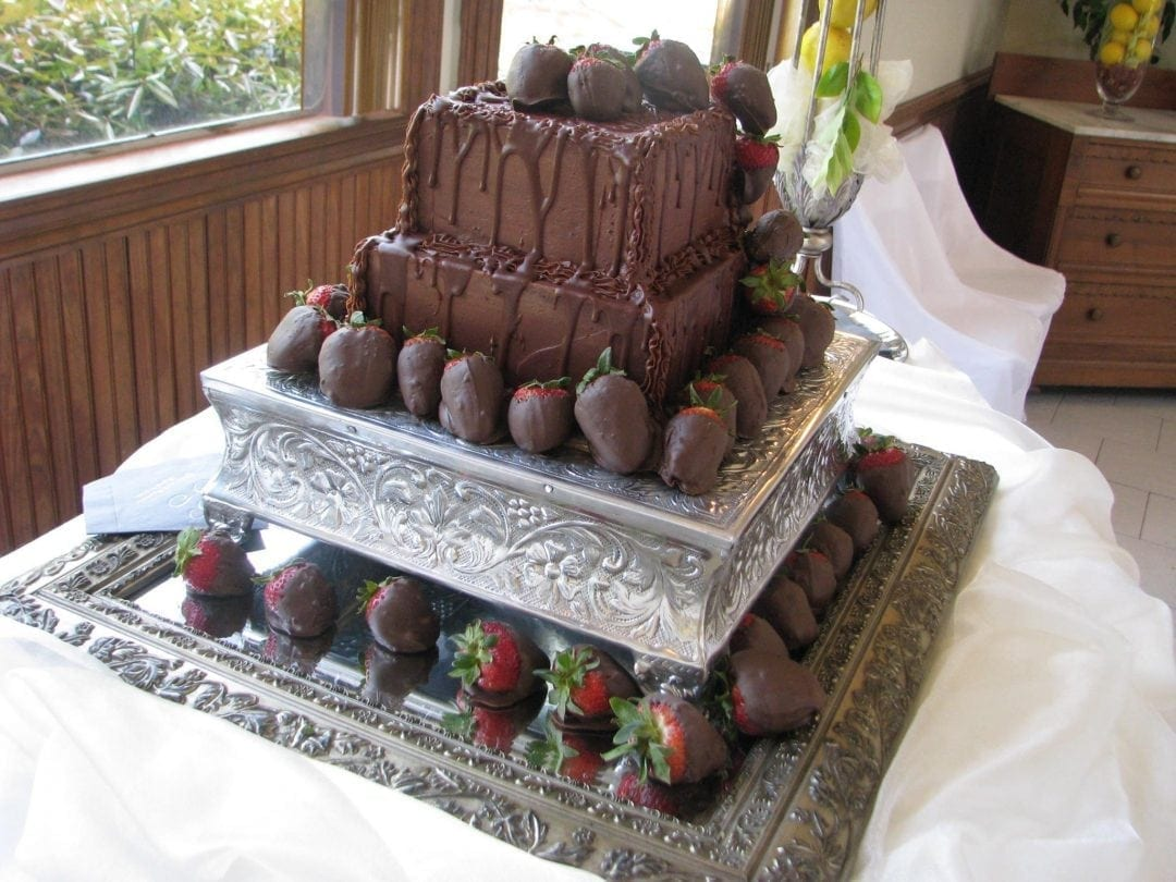 chocolate wedding cake with cascading strawberries